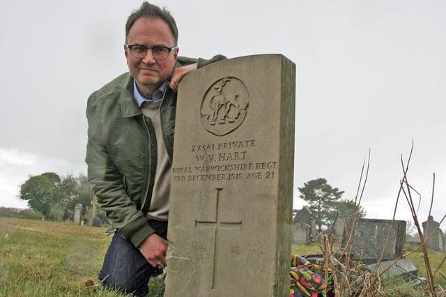 Veteran Chris Butler by the damaged war grave in Kirkby.