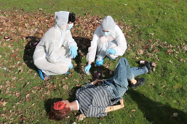 """Dummy run: students used specialist equipment including evidence markers, plastic sheets, tape measures, swabs and containers, in order to determine the cause of """"death."""""""