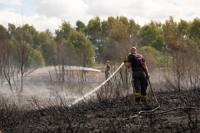 Firefighters tackle a grass fire in the Oak Tree area of Mansfield