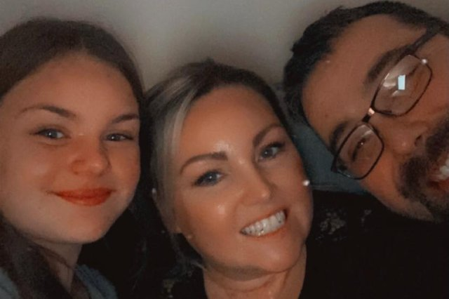 Kerri March is now recovering well but can still only walk a few steps, but is determined to attend her best friend's wedding later this year, She is pictured here with partner Gary and daughter Ellie.