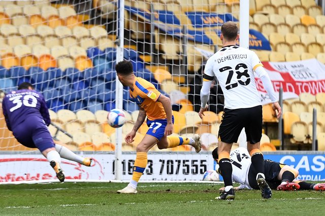Mansfield's Tyrese Sinclair has his header cleared off the line by Newport's keeper Nick Townsend
