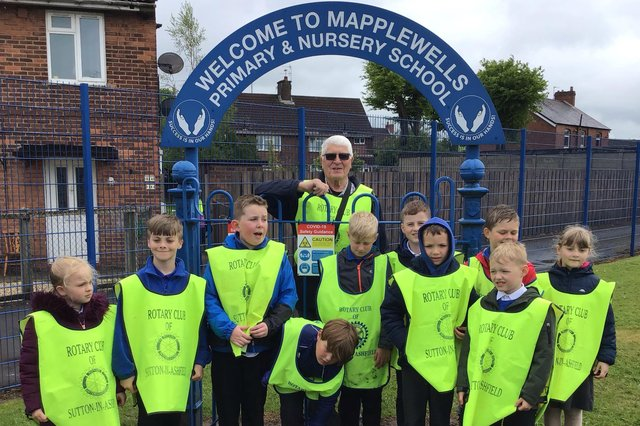 Environment champion Danny Thompson with youngsters at Mapplewells School in Sutton.