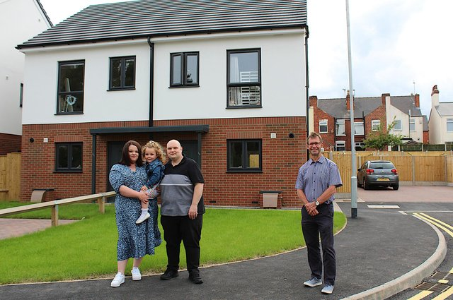 Moving-in tenants Jonathan Gilkinson, Rose Morley and their daughter, Iris, outside their new home on Rosemary Avenue, Mansfield, with the town's Mayor, Andy Abrahams.