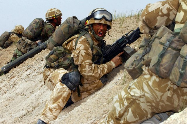 Soldiers in action on the frontline in a war-torn country abroad. (PHOTO BY:  Paul Jarvis/MOD/Getty Images)