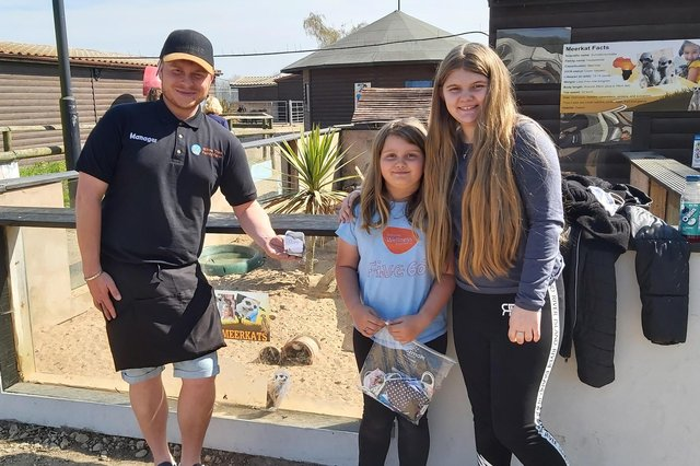 Millie (centre) and cousin Chloe with volunteer director David Taylor outside the meerkats' enclosure at Willow Tree Family Farm in Shirebrook.