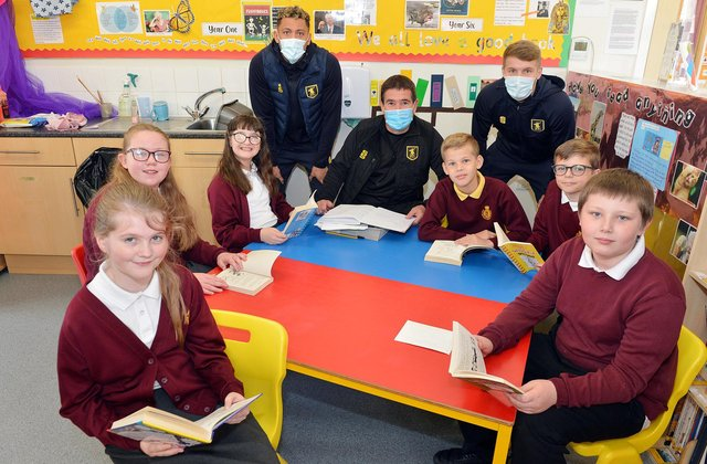 Mansfield Town manager Nigel Clough and player Kellan Gordon and Jason Law visit King Edward Primary School to meet children and read books he enjoyed as a youngster.