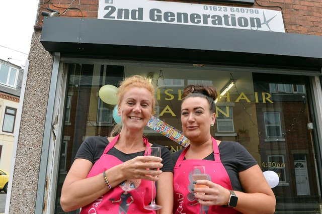 Owner Dallas Seamer and faithful staff member Kelly Moore celebrate the 30th birthday of the 2nd Generation hair salon in Mansfield.