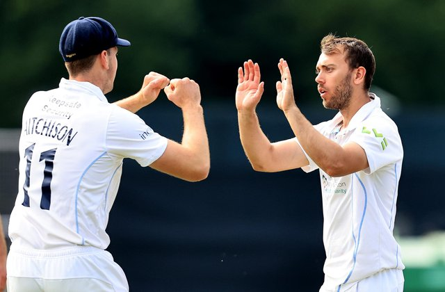 Alex Hughes celebrates with Ben Aitchison after taking the wicket of Tim Bresnan. (Photo by David Rogers/Getty Images)