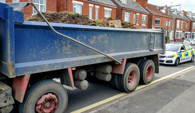 Officers in Shirebrook issued a fine to a truck driver transporting tonnes of soil and rubble without a safety net covering.