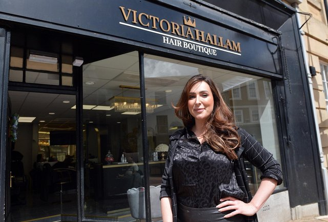 Owner Victoria Hallam outside her new hair salon at  Mansfield's Old Town Hall.