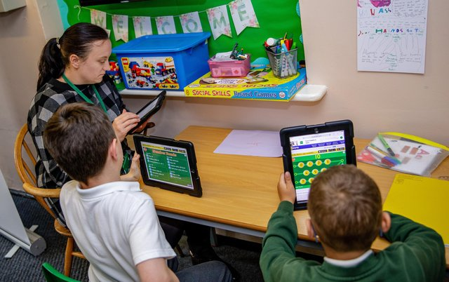 Staff and pupils at Blidworth Oaks Primary School working with the tablets.
