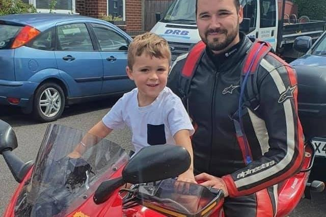 Ben Gillway on his dad's bike, with his four-year-old son Joey.