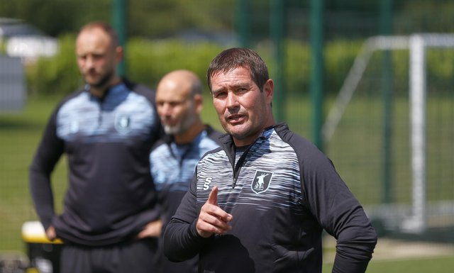 Mansfield Town boss Nigel Clough dishes out the instructions on the first day of pre-season training.