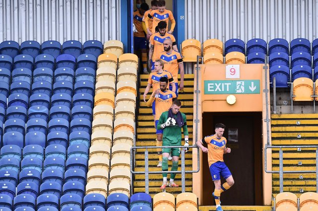 Mansfield Town make their way to the pitch.