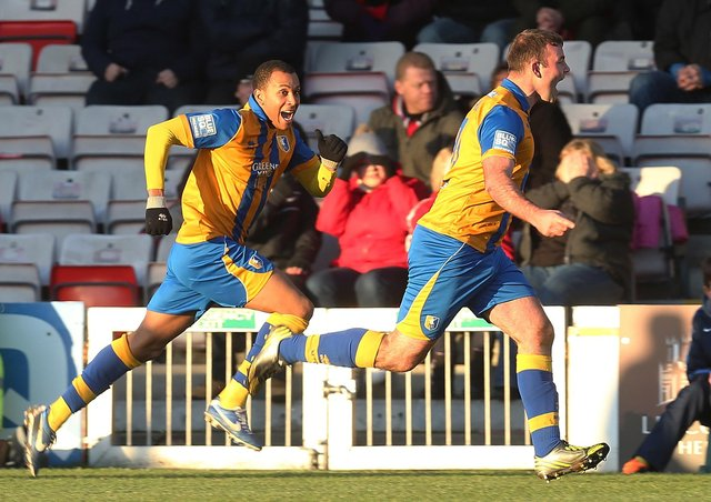 Matt Rhead celebrates after scoring Mansfield's third goal in the FA Cup tie at Lincoln City.  (Photo by Pete Norton/Getty Images)