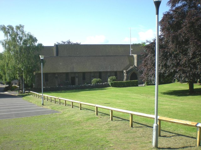 The tractor mower was used to cut the grass close to All Saints' Church in Huthwaite