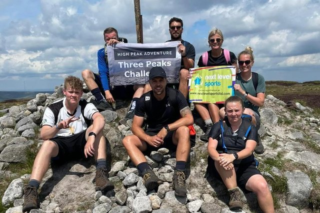 The Next Level Sports team, led by Scott Hardy (centre), reach one of their destinations in the Derbyshire Three Peaks Challenge.