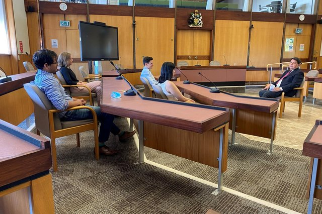 Personnel committee chairman Coun Gordon Wheeler chats to graduates on the graduate development dheme in the chamber at County Hall.