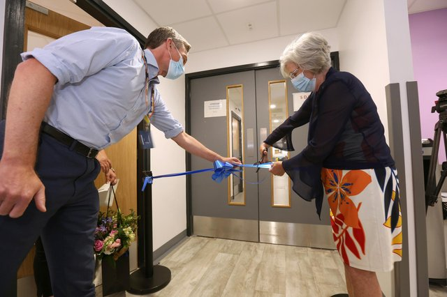 Sherwood Forest Hospitals NHS Foundation Trust's chief operating officer Simon Barton joins the unit's first patient Kathryn Allsop to cut the ribbon at the opening ceremony.
