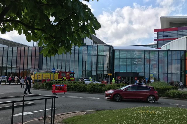 A vehicle has driven into the entrance of the busy hospital
