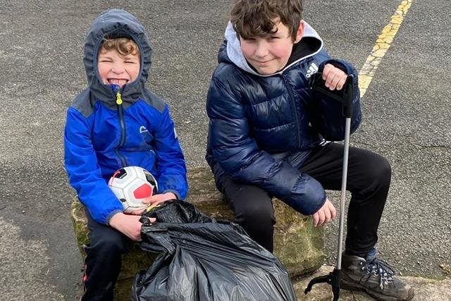 Volunteer litter-pickers, 10-year-old Olly Whitsed and his five-year-old brother Joey, with the rubbish they collected as part of the Just Bin It campaign.