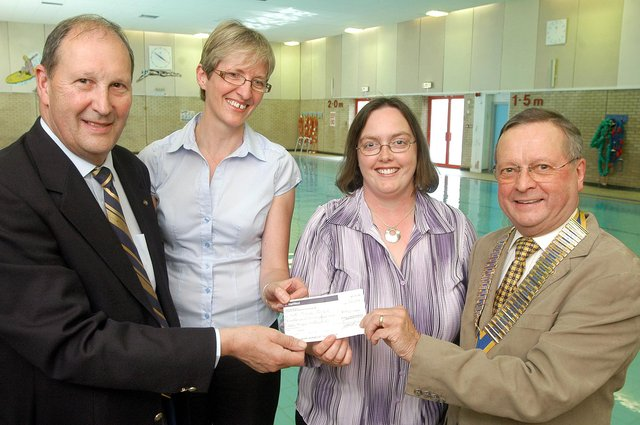 Mike Neville, left, and Mansfield Rotary Club president,  Ray Malkowski,  present a £1552.60 cheque to Michele Pulford, second left, the NCC School Swimming manager and Sandra Warner manager of Rainworth Social Enterprise. The money was used to buy disabled access steps for the community pool.