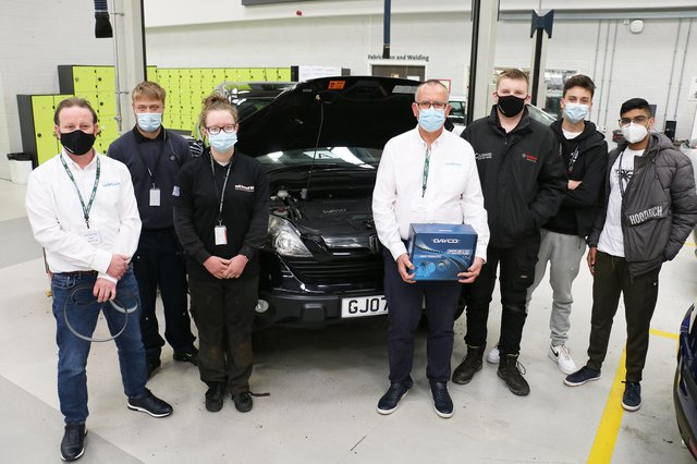 Some of the trainee mechanics with representatives from Dayco