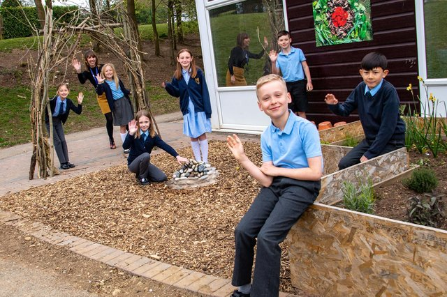 Headteacher Sam Robinson with children of St Mary Magdalene C of E Primary School in their new Garden of Hope