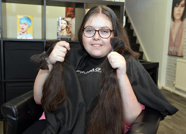 Bethany Snell proudly shows off her chopped off locks.