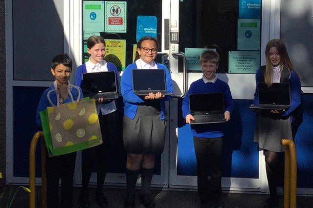 Dalestorth Primary School pupils with their new laptops, donated by Asda.