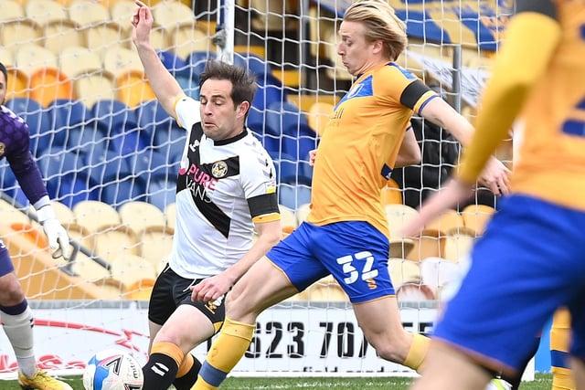 Mansfield's George Lapslie battles with Newport's Matthew Dolan
