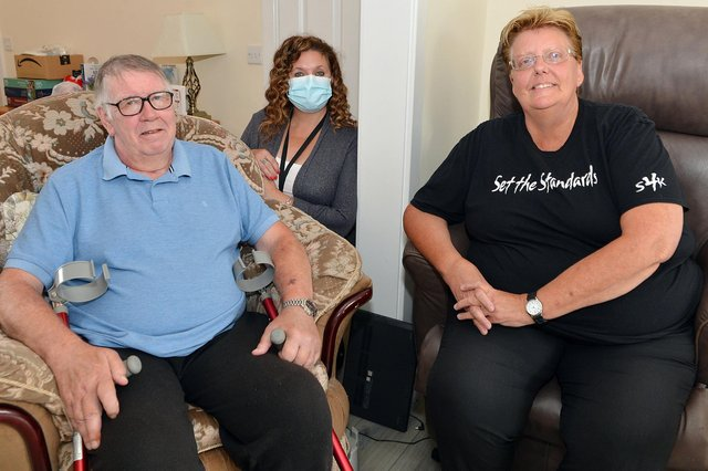 Kirkby grandad Kev Evans with wife Sue and Age UK connect support worker, Deborah Hughes.