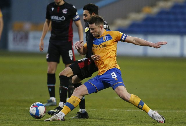 Ollie Clarke in action against Scunthorpe on Tuesday night. Photo: Craig Brough.