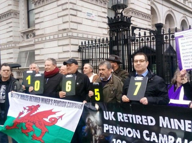Former mineworkers campaigning outside Downing Street for a fairer deal on pensions
