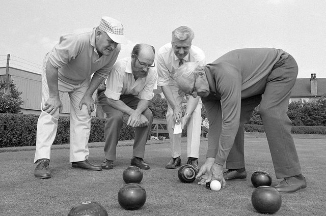 A group of Kirkby bowlers measure a shot back in 1970.