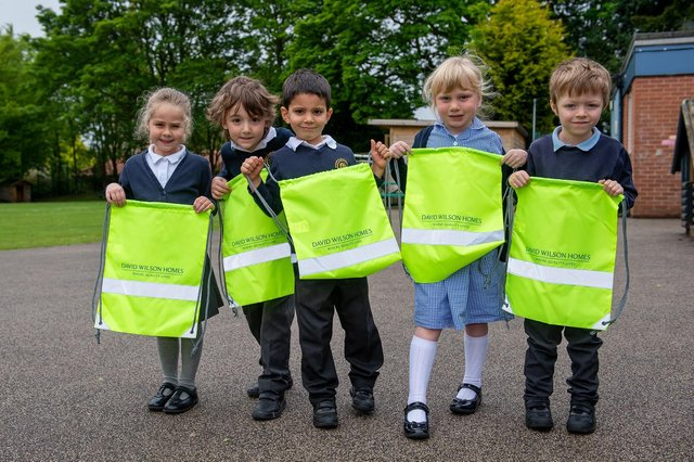 The pupils at St Mary's C of E Primary School with their new kit bags donated by David Wilson Homes