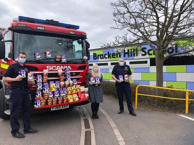 Kelly Jefferies, one of Bracken Hill School's assistant headteachers being given the eggs by firefighters from Ashfield Fire Station, who dropped them off at the school.