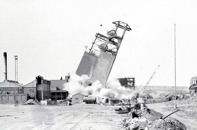 Shirebrook Colliery headstocks are demolished in 1993, following the pit's closure in May that year.