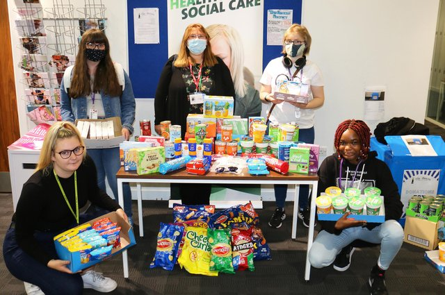 Louisa Hillman, manager of The Beacon Project, (centre back) with health and social care students' generous hampers
