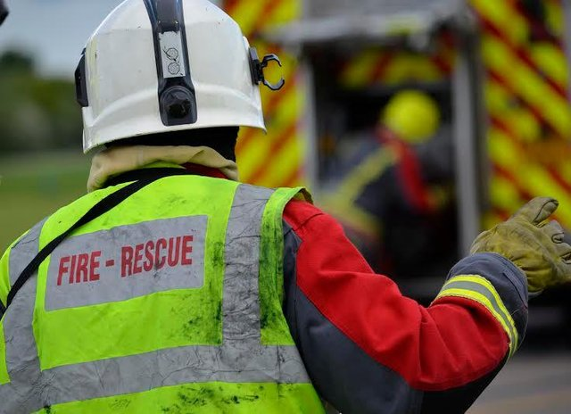 A woman was pulled to safety froma house fire in Kirkby on Sunday evening.