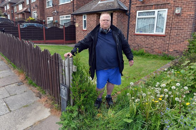 Tenant Tony Eaton by the gap that has been left since the removal of the hedge at his Mansfield home.