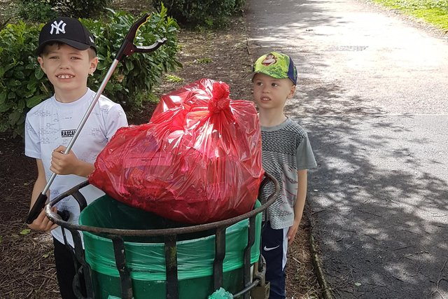 Two youngsters with the fruits of their labours after a litter-pick at Racecourse Park in Mansfield.