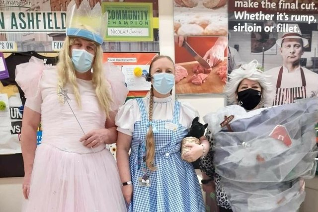 Staff from Kirkby Morrisons dressed as characters from the Wizard of Oz