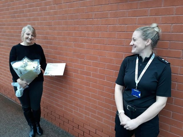 Former Nottinghamshire police officer Paul Roker, left, receives her commendation at last year's policing awards.