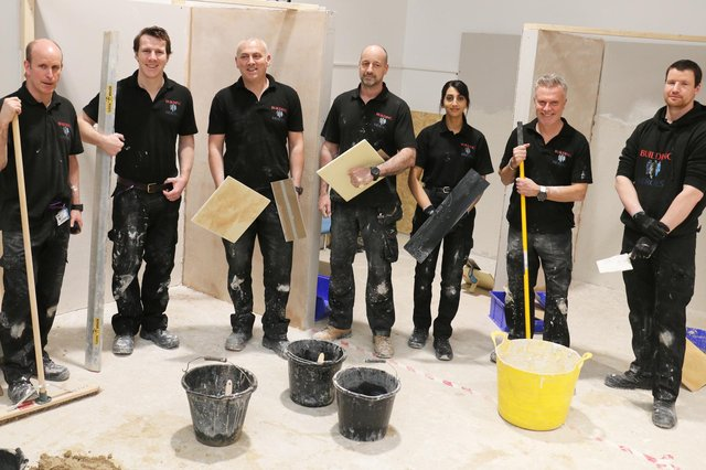 A group of military veterans and service leavers in the construction workshop at West Notts College's centre at Station Park, Kirkby.