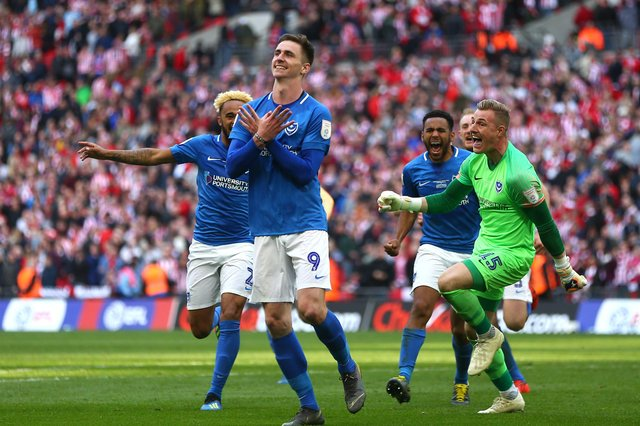 Oli Hawkins celebrates after scoring the winning penalty in the Checkatrade Trophy Final for Portsmouth against Sunderland at Wembley Stadium in March 2019.