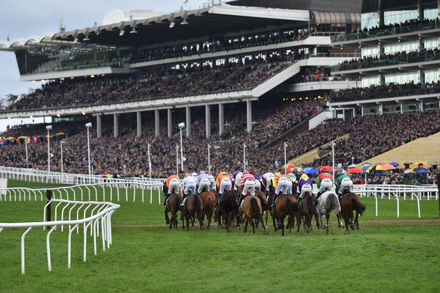 Packed stands watching the action unfold at the Cheltenham Festival. (PHOTO BY: Glyn Kirk/Getty Images)