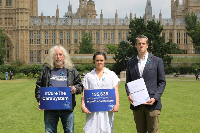 Laura Smart, campaigns manager at Alzheimer's Society, pictured centre on the day of the petition handover, with campaign supporters Dave Thomas (left), who has cared for his best friend Bonnie and Jonathan Freeman, who was responsible for the care of his mum, who lived with dementia.