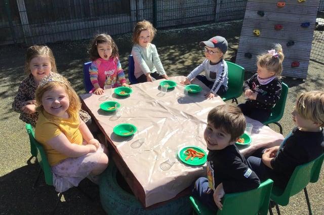 The children at Cherubs Edwinstowe enjoy eating their meals outside