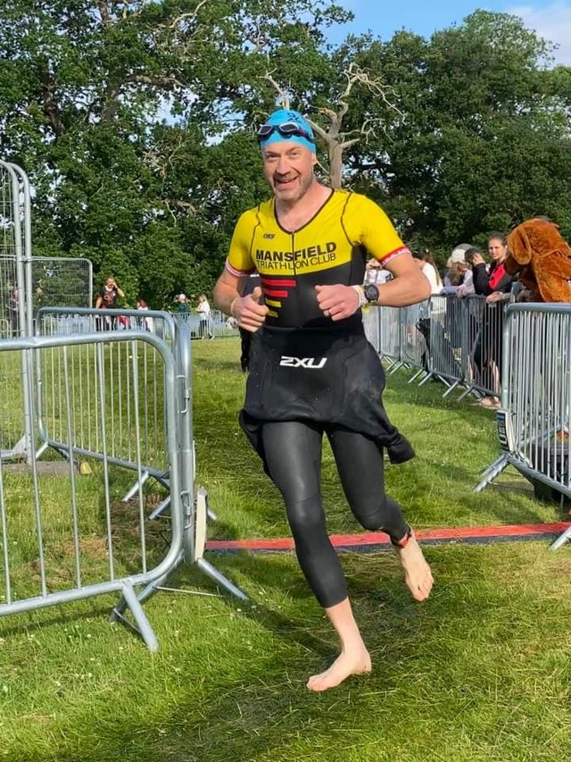 Daniel Wilson in transition between swim and run at Holkham